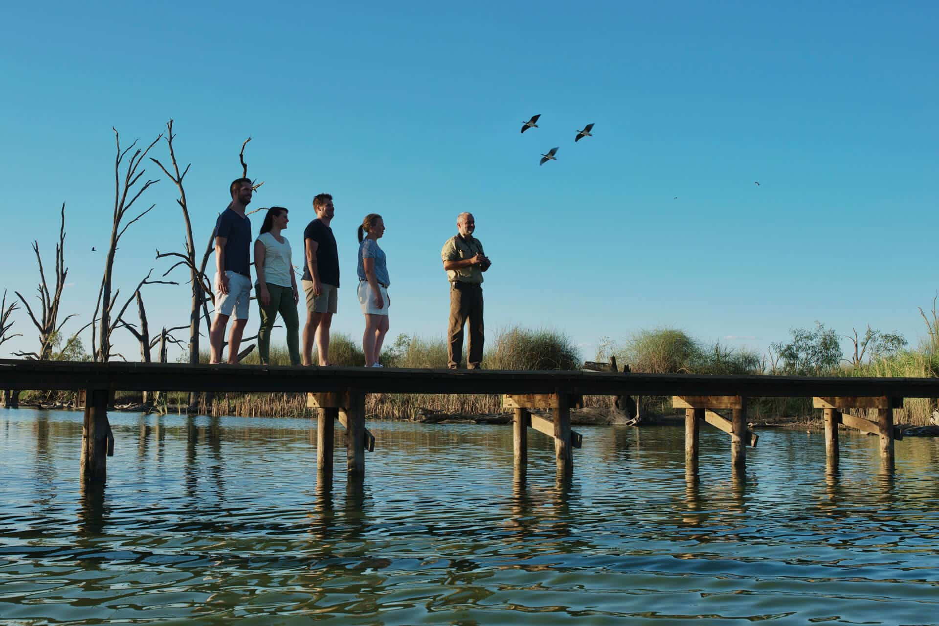 Group with tour guide on jetty