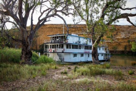 Proud Mary docked on riverbank with gumtrees