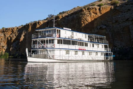 Proud Mary on the Murray River by cliffs