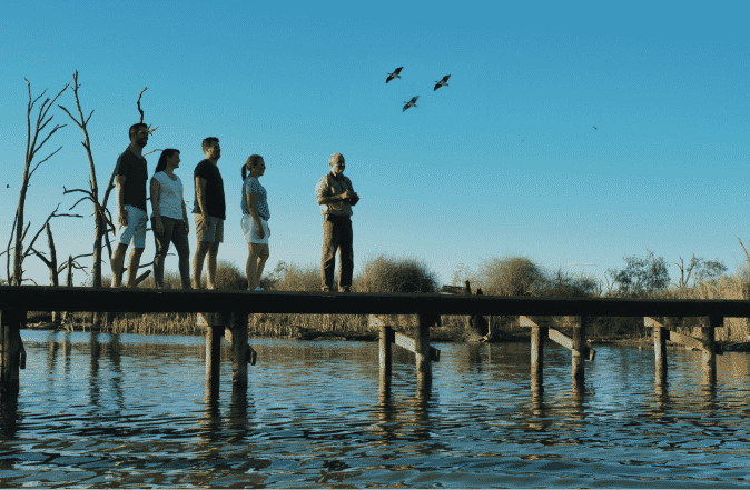 Group with tour guide on jetty on the Murray River