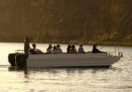 Tour group in boat at dusk