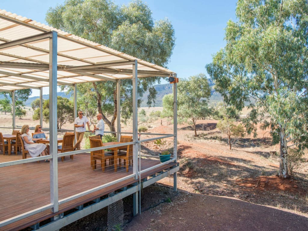 People enjoying drinks on a balcony in Flinders Ranges
