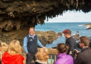 Tour group at Admirals Arch on Kangaroo Island