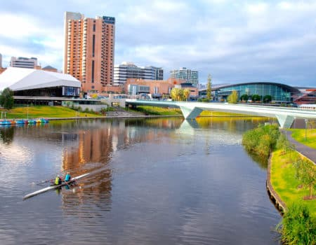 Adelaide city with rowers on lake