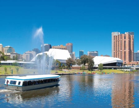 Adelaide city with tour boat on lake