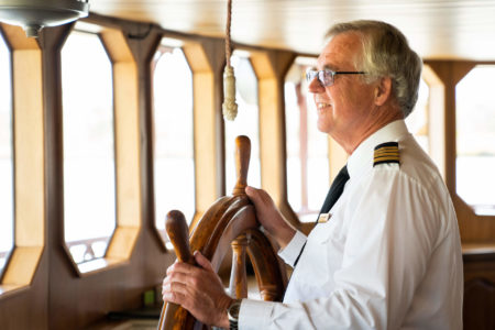 Captain at the wheel of the Murray Princess