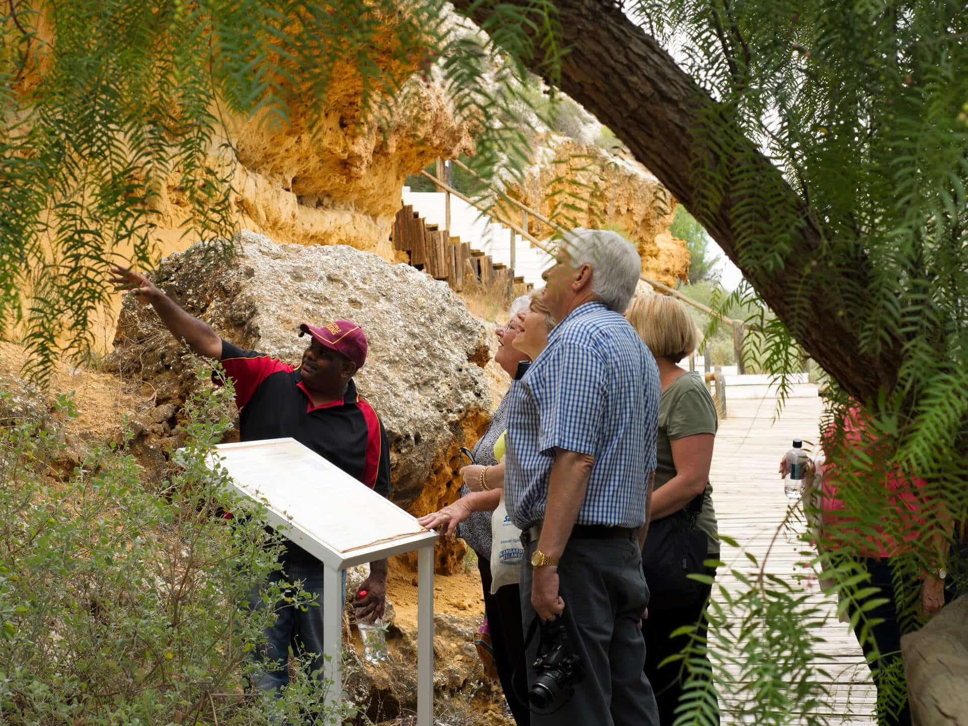 Guide takes group on tour of the Ngaut Ngaut Aboriginal Reserve